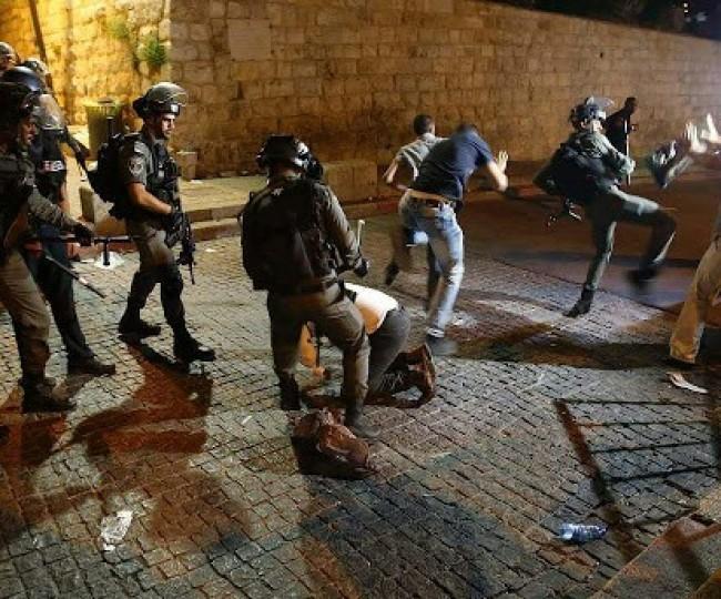 اشتباكا مسلح في جنين وحملة مداهمات واعتقالات واسعة في الضفة