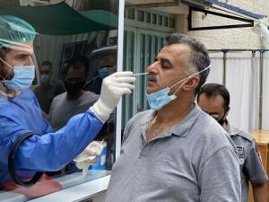 11 وفاة و809 إصابات جديدة بكورونا بالضفة وغزة